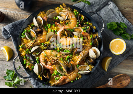 Homemade Spanish Seafood Paella with Prawns Mussels and Clams - Stock Photo