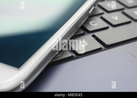 A White Mobile On A Keyboard With Search Button #2 - Stock Photo