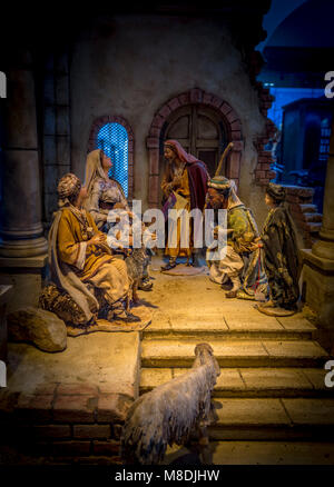 Illuminated Christmas crib in Bolzano, South Tyrol, Italy, Europe - Stock Photo