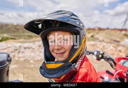 Portrait of boy wearing crash helmet, close-up, La Paz, Bolivia, South America - Stock Photo