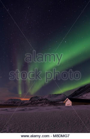 Aurora borealis over snow covered landscape, Snaefellsnes peninsula, Iceland, Europe - Stock Photo