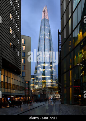 Pedestrian zone and view of The Shard at dusk, London, UK - Stock Photo