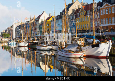 Moored boats and colourful 17th century town houses on Nyhavn canal, Copenhagen, Denmark - Stock Photo