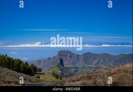 Gran Canaria, March 2018,  view along a small valley, Roque Bentayga, Altavista and Teide on Tenerife lined up - Stock Photo