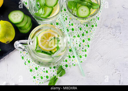 Refreshing cucumber cocktail, lemonade, detox water in a glasses on a white background. Summer drink. Top view - Stock Photo