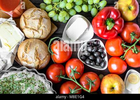 Healthy breakfast ingredients of  vegetarian food, fruits and vegetables, flat lay - Stock Photo
