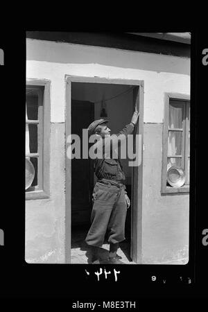 The 'Mazuza' being touched by Yemenite youth when passing through the doorway LOC matpc.18421 - Stock Photo