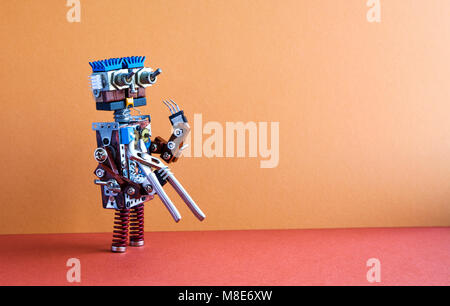 Robotic maintenance repair fixing service concept. Robot handyman with pliers. Brown wall, red floor background, - Stock Photo
