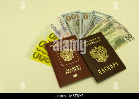 Russian European passport provides a different dollars , and three Euro banknotes on a white background - Stock Photo