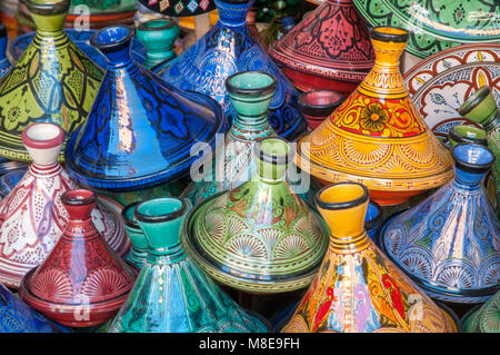 Decorative ceramic tagines on display in a pottery shop in the souks just off the Jemaa el-Fna square in Marrakesh, - Stock Photo