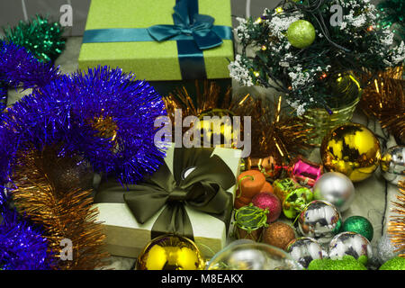 Christmas tree toys different colors balls, gifts, deer mask on a dark background, Christmas New Year holidays preparation - Stock Photo