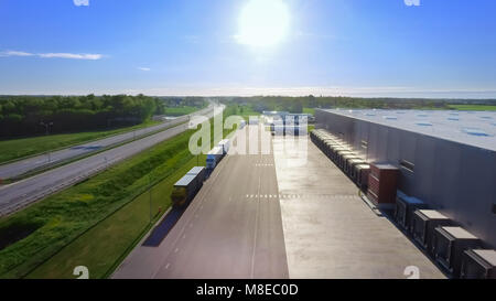 Aerial View of Loading Warehouse with Semi Trucks Parked and Waiting for Loading. Big Industrial Buildings, Supermarket - Stock Photo