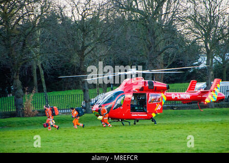 London, UK, 16/03/20018 London air ambulance in action on Wandsworth Common. Credit: JOHNNY ARMSTEAD/Alamy Live - Stock Photo