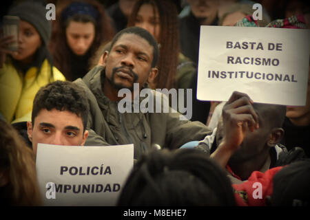 Barcelona, Spain. 16th Mar, 2018. A protester seen holding placards during a demonstration in memory of Mame Mbaye.Mame - Stock Photo