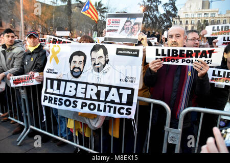 Barcelona, Spain. 16th Mar, 2018. A banner with the face of Jordi SÃ nchez and Jordi Cuixart seen during the protest.Hundreds - Stock Photo