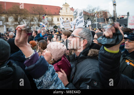 BRATISLAVA, SLOVAKIA - MAR 16, 2018: Protesters hold keys during an anti-government demonstration demanding a change - Stock Photo
