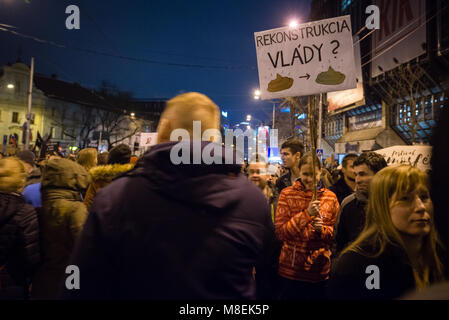 BRATISLAVA, SLOVAKIA - MAR 16, 2018: Protesters hold signs during an anti-government demonstration demanding a change - Stock Photo