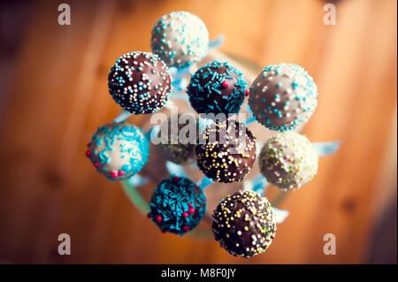 arranged cakepops with sweet little balls prepared to eat - Stock Photo
