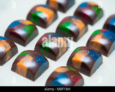 Set of colorful luxury handmade bonbons on white background. Exclusive handcrafted chocolate candies. Product concept - Stock Photo