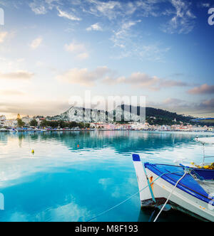 fishing boats in Zaante town harbour under sunset sky, Zakinthos Greece - Stock Photo