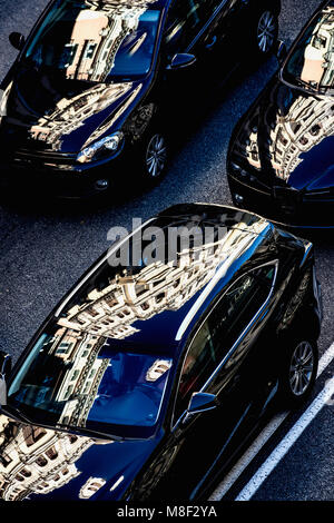 City buildings reflecting in cars on Gran Via - Stock Photo
