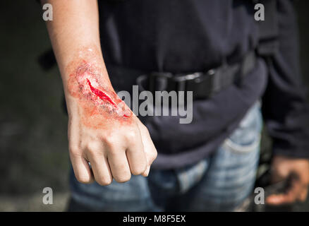 acidence scar make up artist on stuntman hand in cinema industry - Stock Photo