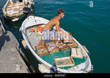 SANTA MARGHERITA LIGURE, ITALY, JULY, 12, 2017 - Young fisherman returns to the port after a fishing day, Genoa - Stock Photo