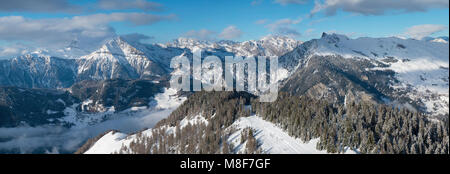 Snowy panoramic picture of mountains seen from the Verbier ski area - Stock Photo