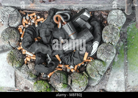 bicycle lock lying in an ashtray in an outdoor area