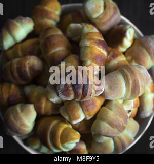 Mini croissants filled with cheese  in the basket from above,selective focus - Stock Photo