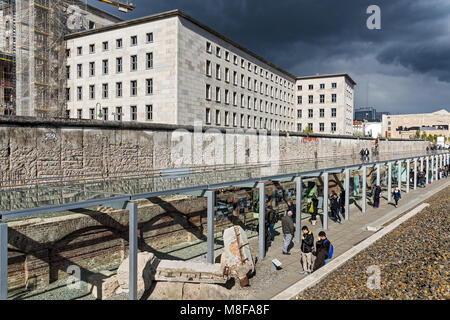 Tourists visit the Topography of Terror, an outdoor and indoor history museum on April 19, 2017 in Berlin, Germany. - Stock Photo
