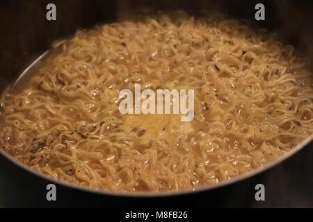 Ramen is a Japanese dish. It consists of Chinese-style wheat noodles served in a meat or fish-based broth, often - Stock Photo