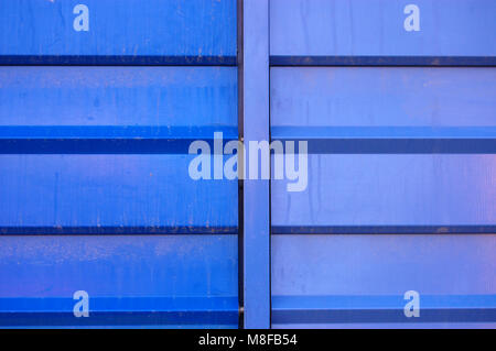 metallic wall of a building in two blue tones - Stock Photo