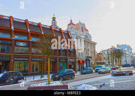 VIlnius, Lithuania - January 05, 2017: Unknown people go along street in Old Town, Vilnius, Lithuania - Stock Photo