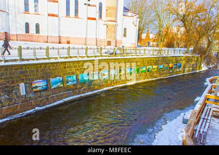 VIlnius, Lithuania - January 05, 2017: Vilnele river flowing past Uzupis district, a neighborhood in Vilnius, Lithuania, - Stock Photo