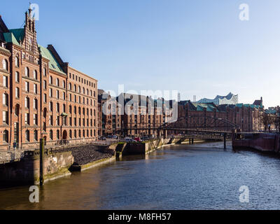 Hamburg, Germany - April 21, 2016:  View from bridge at old warehouse district and Elbphilharmonic Hall in Hamburg - Stock Photo