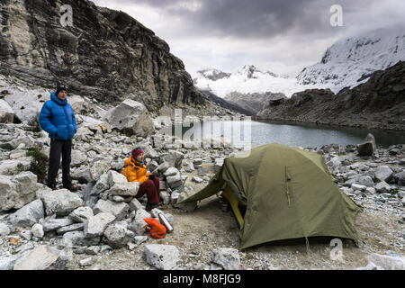 man and woman mountain climber couple at a base camp in the Cordillera Blanca in the Andes in Peru