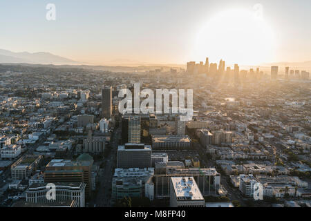Los Angeles, California, USA - February 20, 2018:  Early morning aerial view of towers, streets and buildings along Wilshire Bl and downtown LA. Stock Photo
