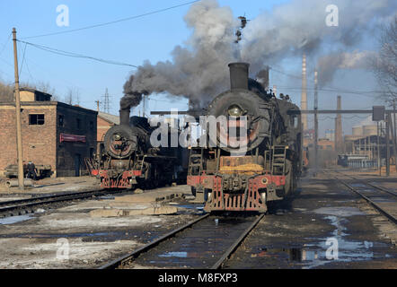 Locomotives at the maintenance depot in Fuxin. The coal mine system at Fuxin, Liaoning province, China, used steam - Stock Photo