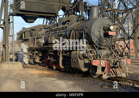Locomotive at the maintenance depot in Fuxin. The coal mine system at Fuxin, Liaoning province, China, used steam - Stock Photo