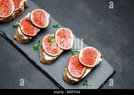 Bruschetta with blue cheese and fresh figs - Stock Photo