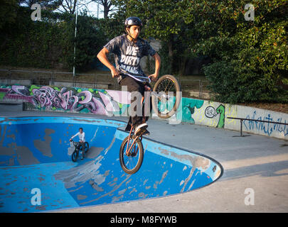GENOA, ITALY NOVEMBER 16, 2015 - Boy jumping with BMX bike on a BMX session in the city. - Stock Photo