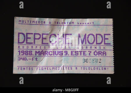 Magdeburg, Germany - March 17, 2018: Vintage concert ticket of the pop band Depeche Mode, who gave a concert behind - Stock Photo