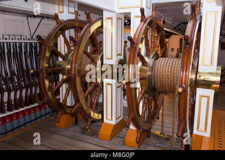Ships wheels / steering position / gun deck / helm HMS Warrior. Portsmouth Historic Dockyard / Dockyards. UK. Wheel - Stock Photo