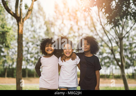Children Friendship Togetherness Smiling Happiness Concept.Cute african american little boy and girl hug each other - Stock Photo