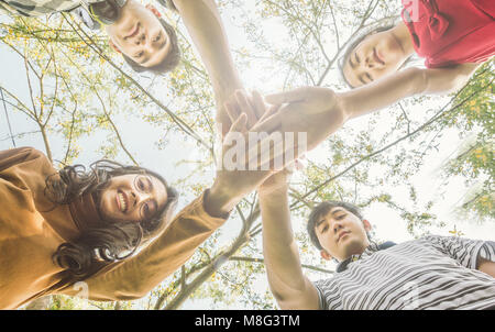 Asian College Students Teamwork Stacking Hand Concept - Stock Photo