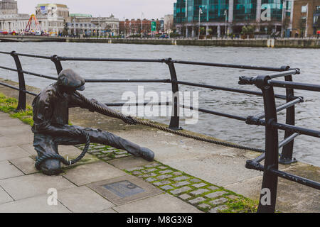 DUBLIN, IRELAND - 17th March, 2018: The Linesman statue on the river Liffey on the Dublin's city quay - Stock Photo