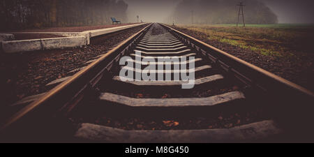 rails of the railway station at the station. Autumn season, in the countryside. Panoramic and web banner format. - Stock Photo