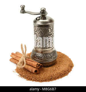 cinnamon and manual grinder isolated on white background - Stock Photo