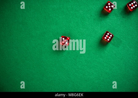Red dices on green poker table. - Stock Photo